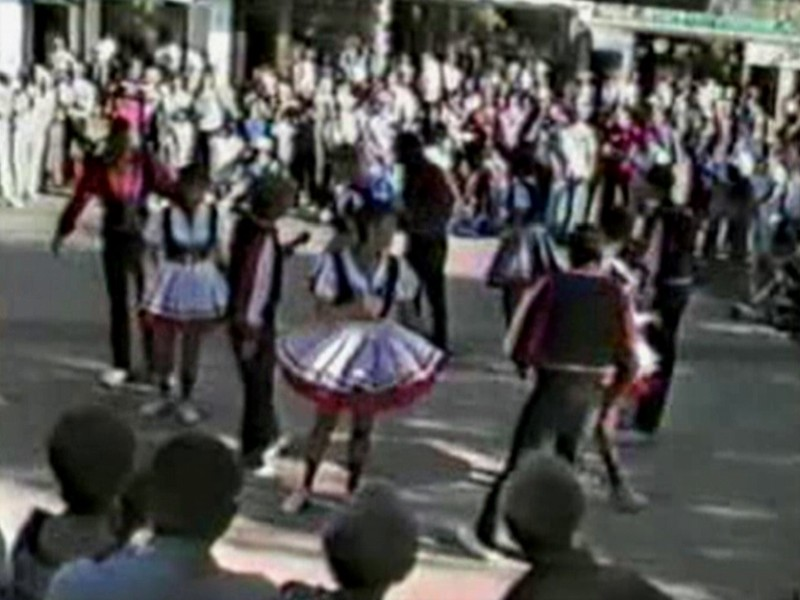 """Video Archive Clip 1987 (May) - Yaden Clogging - Dan & Julie (age 33) dance the Glendale Train routine at the Leavenworth Mayfest - Toe Tappin' Cloggers - Leavenworth, WA - Clogging Memoirs Series (2 min 54 sec)<br /> <br /> Dan's note:<br /> <br /> In December of 1986 Julie saw an ad for """"Learn How to Clog"""" lessons being held in Yakima. She thought it would be fun to check it out. I told her fun for her because she can dance, not so much for me because I can't. Naturally, I lost the argument and here we are in May of 1987 performing for the hordes. We start out in the back of the circle away from the camera, then spend most of the dance to the left of the screen. Julie is the cute one with the short dark hair. I'm the dork with the red mustache and sporting a """"light perm"""" that went horribly wrong......"""