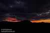 Pink and orange sunset colors over the silhouetted mountain and under mostly-grey clouds (11/2/2013, Wrights Rd.)<br /> EF24-105mm f/4L IS USM @ 65mm f7 1/332s ISO1600