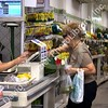 Customer in the checkout line at a supermarket in Rio de Janeiro, Brazil.