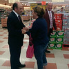 At a surprise visit Sunday to the Bridge Street (Lowell)  Market Basket, reinstated CEO Arthur T. Demoulas shakes hands and thanks loyal customer Lisa Baratta Casey, of Dracut, with store manager Andy Heggarty in background. courtesy photo