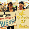 Loyal Dracut Market Basket customers Sue D'Hondt (left) of Dracut and Christine Fleming (right) of Tyngsboro, hold the protest signs they held during the six-week boycott,