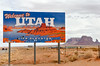 Utah State Line with Monument Valley Background