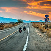 Route 66 Riders<br /> Route 66 motorcycle riders travel into the southern California desert sunset.