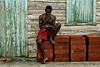 The Cuban literacy rate is an overwhelming 98%, so seeing people reading is no rarity.<br /> Small village North of Viñales,<br /> <br /> Cuba, 2006.