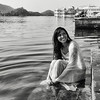 Young woman washing herself in lake Pichola.  Udaipur, Rajasthan, 2011.