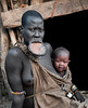 Woman and her baby from the Mursi tribe.