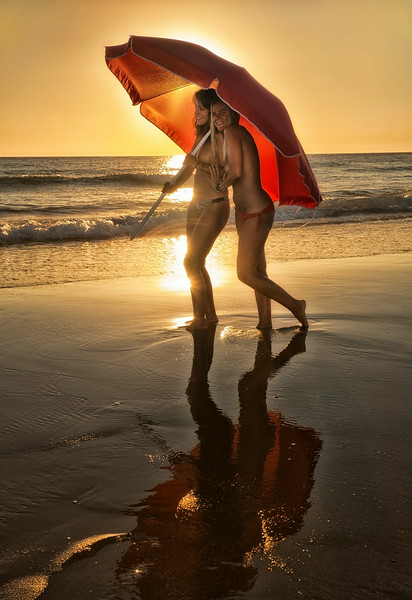 Two women enjoying a stroll along the El Palmar beach.<br /> <br /> Vejer, Andalucia, Spain