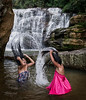 Vasena (18) and Akila (11) from the town of Palogole are  playing while washing there hair in a water fall near the mountain town of Nuwara Eliya.  Sri Lanka, 2014.
