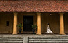 A bride walking past one of the many historical buildings in Galle Fort.  Sri Lanka, 2014.