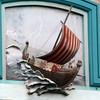 Viking ship on Maelstrom sign