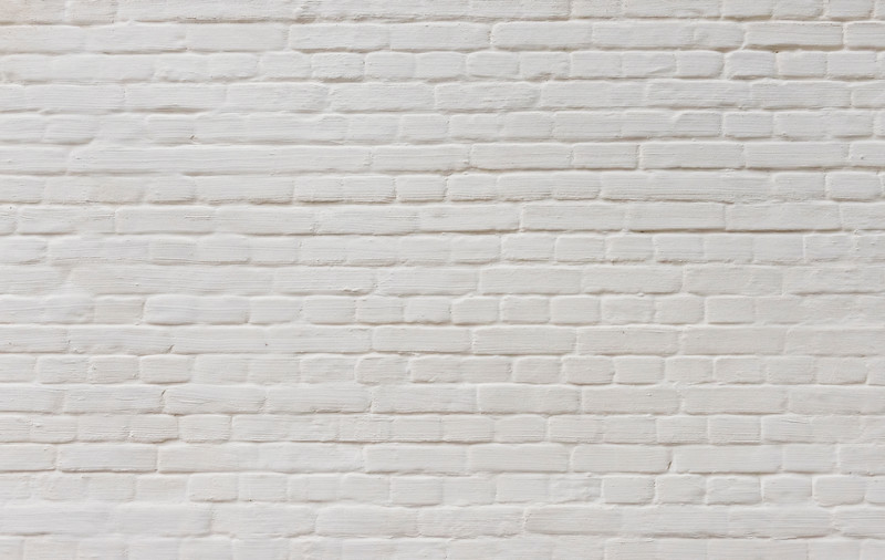Background of  vintage brick wall covered with white plaster