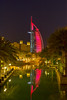 The Madinet Jumeirah and the Burj al Arab Hotel lighted at night in Dubai, UAE.