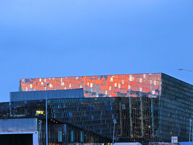 A sunset reflection on the Harpa Opera House.