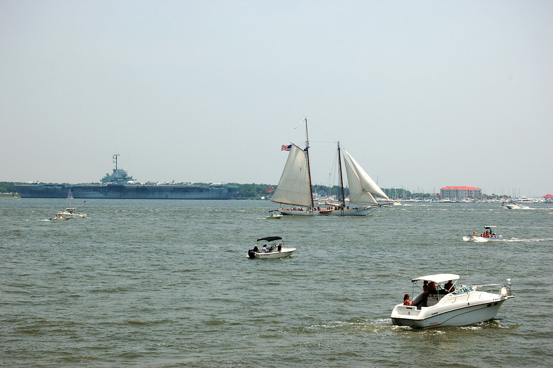 June 28, 2009<br /> The tallship The Spirit of South Carolina, sailboats and other recreational boaters sail along the Cooper River in Charleston Harbor with the aircraft carrier Yorktown in the distance. (Photo/Andy Owens)