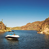 SeaRay ski boat with black couple on Lake Saguaro