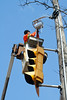 Electrician repairing traffic light