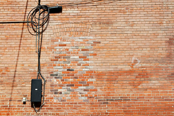 Antique brick wall with electrical wire