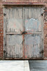 Old wood factory door with faded paint