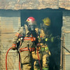 Enid firefighters battle a fire at 3011 W. Phillips Road Thursday, August 21, 2014. A rural postal carrier noticed the flames at 10:37 a.m. and called 911. The structure, on the property of active Enid firefighter Tim Dowers, was a total loss. The Enid Fire Department, Enid Police Department, and Kremlin Volunteer Fire Department responded to the scene. (Staff Photo by BONNIE VCULEK)