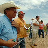 Area farmers gather west of Cherokee during a tour of a plotted sorghum field with Rick Kochenower, OCES NW Area Agronomist, Dr. Tom Royer, OSU IPM Coordinator, Trent Milacek, NW Area Economist and Jeff Bedwell, NW Area Asst. Agronomist, Tuesday, August 26, 2014. (Staff Photo by BONNIE VCULEK)