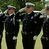 "Enid Police Officers salute during the Celebration of Life for Retired Capt. Glenn ""Red"" Willard Harmon at Memorial Park Cemetery Tuesday, August 26, 2014. (Staff Photo by BONNIE VCULEK)"