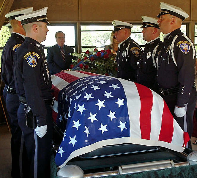 "The Enid Police Department Honor Guard honor Retired Capt. Glenn ""Red"" Willard Harmon during Harmon's Celebration of Life and Interment at Memorial Park Cemetery Tuesday, August 26, 2014. (Staff Photo by BONNIE VCULEK)"