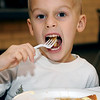 Henson Reames, 4, devours his pancakes during the 15th annual March of Dimes Breakfast with Santa at Enid High School Saturday, Dec. 7, 2013. (Staff Photo by BONNIE VCULEK)