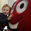 A young child gives Cherry Berry a hug during the 15th annual March of Dimes Breakfast with Santa at Enid High School Saturday, Dec. 7, 2013. (Staff Photo by BONNIE VCULEK)