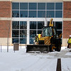 Landscaping continues around the Enid Event Center as workers remove snow and ice Wednesday, Feb. 12, 2014. (Staff Photo by BONNIE VCULEK)