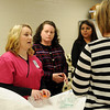 Healthback Home Health's Maggie West (left), the new RN coordinator at the YWCA, discusses additional supplies needed for the medical examination room Friday, Jan. 10, 2014. St. Mary's Regional Medical Center donated medical equipment and $5,000 to the YWCA to help cover expenses for the program. (Staff Photo by BONNIE VCULEK)