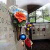 Floral arrangements and mementos decorate the interior of the Memorial Park Cemetery mausoleum Thursday, June 5, 2014. The mausoleum, completed in 2009, is part of the cemetery's $1 million improvements. (Staff Photo by BONNIE VCULEK)