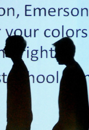 The shadows of two choir students reflect on a copy of the original Emerson school song during the 90th birthday celebration at Emerson Middle School Friday, May 17, 2013. (Staff Photo by BONNIE VCULEK)