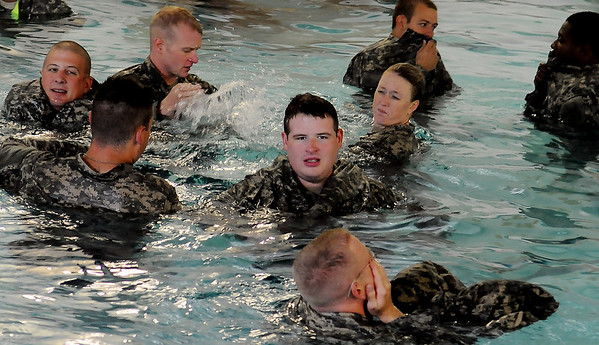 Reserve members at Vance Air Force Base use their camouflage pants as flotation devices during water emergency military training at the Denny Price Family YMCA Saturday, Sept. 14, 2013. (Staff Photo by BONNIE VCULEK)