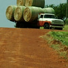 An area farmer turns into a field as he moves 10 large, round bales per load Tuesday, Sept. 2, 2014. (Staff Photo by BONNIE VCULEK)