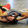 Enid Plainsmen's Billy Grothe gets a near fall as he dominates Maize's Monty Stoner with a 20-5 win during a 132 pound match at the Mid-America Nationals Wrestling Championships at the Enid Event Center Friday, Dec. 13, 2013. (Staff Photo by BONNIE VCULEK)