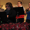 "NJC jazz band members, form left; Donn Folkerts on trombone, Kimberly Harford on alto saxophone, and Kimela Schlup and Stephanie Taylor on trumpets, perform ""Christmas Swings,"" during the NJC Winter Ensemble Concert, Saturday, Dec. 7, 2013."