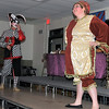 The Jester (Matthew Heimbegner) and Mertonsire (Kortney Forbes) entertain the crowd at Sterling High School's annual Madrigal Dinner, Tuesday, Dec. 3, 2013.