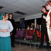 Mertonsire (Kortney Forbes), right, challenges a cast of characters to a story telling contest, during Sterling High School's Madrigal Dinner, Tuesday, Dec. 3. 2013. Characters include, from left; Sylvania (Cassandra Rieb), Silvia (Meghan Anderson), Cyril (Donnie Wright) and Sylvester (Caleb Hanson).