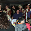 "Wandering carolers perform ""Rudolph the Red Nosed Reindeer"" for one of the tables at Sterling High School's Madrigal Dinner, Tuesday, Dec. 3, 2013."