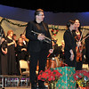 From left; Sarah Romero, Darline Miner and Kim Schlup, trumpet; Lyndsey Green, Camille Rose, Heather Lerdal and Sam Edgar, violin; and Matt Heimbegner, oboe, stand for applause following the Master Chorale 22nd Noel concert, Sunday, Dec. 8, 2013.