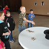 The teams tried to toss pennies and quarters into a top hat as part of the Overland Trail Museum's Presidents Day Showdown Saturday.