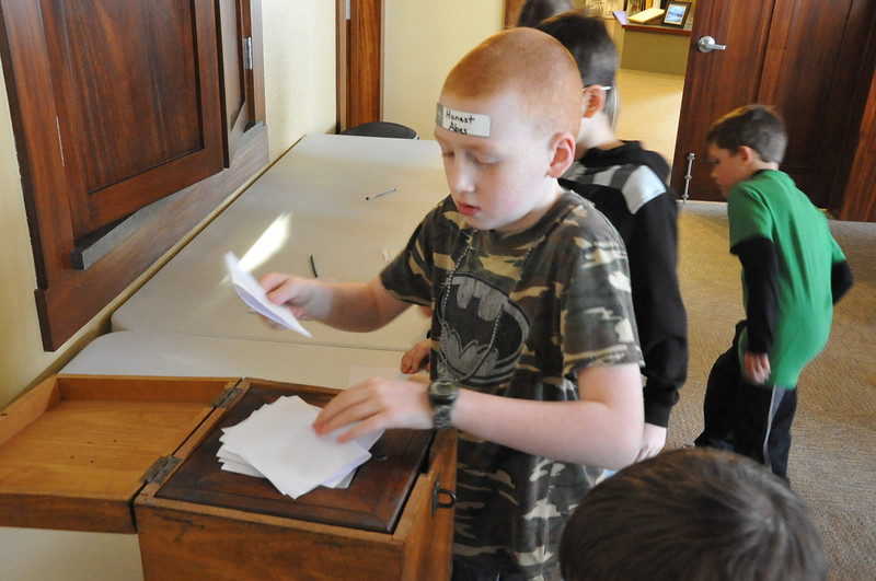 Children voted for their favorite president -- Abraham Lincoln or George Washington -- using Logan County's first ballot box to end the Overland Trail Museum's Presidents Day program Saturday. Lincoln won by a landslide.
