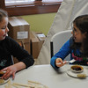 In honor of George Washington's and Abraham Lincoln's favorite treats, the children at the Overland Trail Museum's Presidents Day program enjoyed cherry pie and gingersnaps.