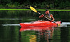 Louis Morales paddles his kayak down the Holston River was he looks  for a good  fishing spot Wednesday. Photo by David Grace
