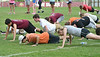 Members of the D-B band do push-ups after messing up a part of their routine. Photo by Ned Jilton II