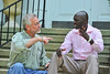 Danny Howe talks with Mandela Wani Michael. Photo byDavid Grace