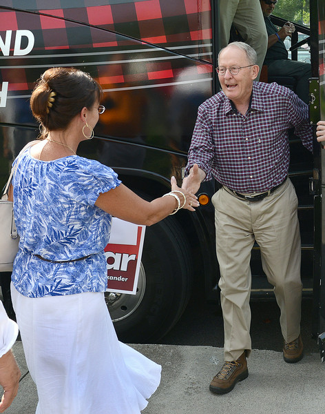 Lamar Alexander is greeted as he gets off the bus at Warriors Path State Park. Photo by Ned Jilton II