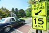 Motorist drives over a traffic calming device on Watauga Street Thurs day . City leaders have made changes to the regulations governing the placement of the devices. Photo by David Grace