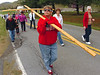 Marilyn Ward carries the cross as members of United Methodist Churches in the Bloomingdale Community commemorate Good Friday with a walk from Holly Springs United Methodist to Salem United Methodist Church. This is the fifth year they have carried the cross for Good Friday but it was the first time that Marilyn has carried the cross. Photo by Ned Jilton II