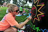 Kristen Cumbow paints her entry for  the Trash Barrel Paint-In for Fun Fest 2014. Photo by David Grace